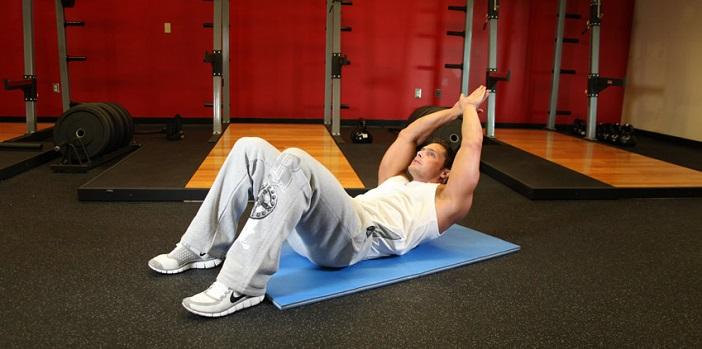 abdominales con brazos extendidos