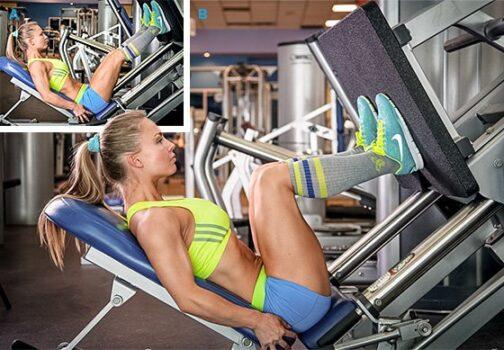 mujer haciendo prensa de piernas paso a paso